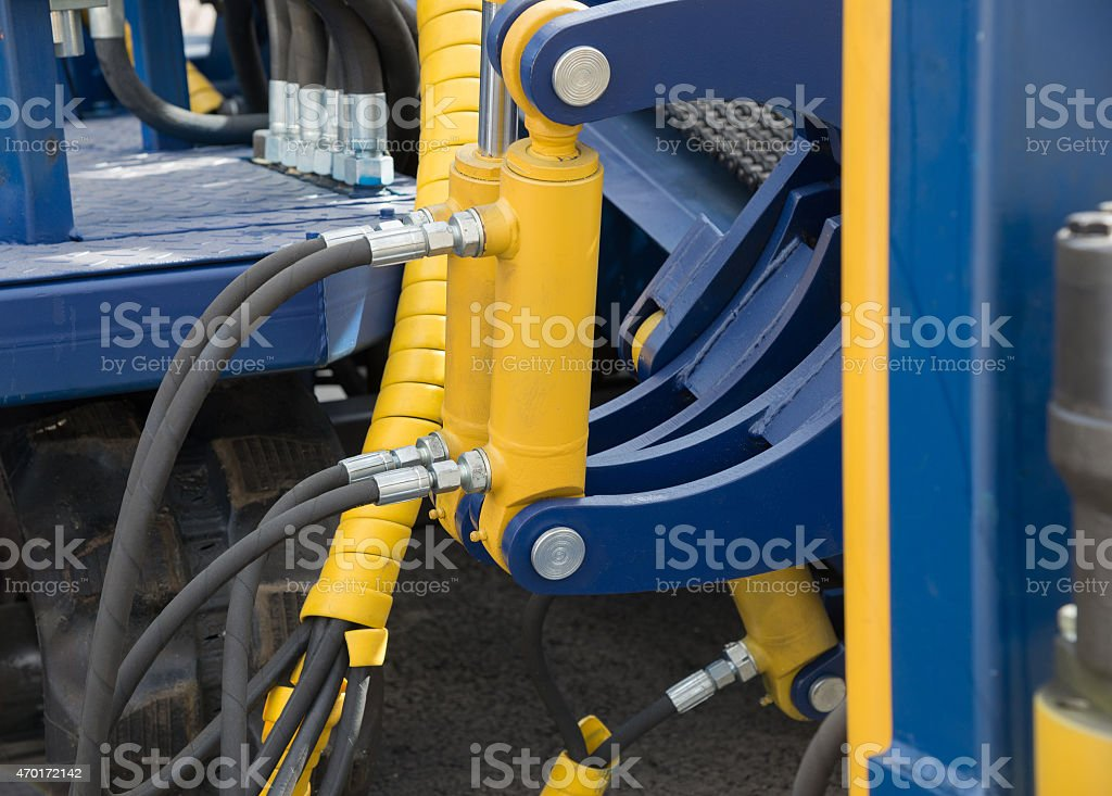 Hydraulic pressure pipes and piston system stock photo