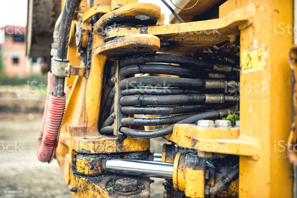 hydraulic pressure pipes and tubes of industrial bulldozer stock photo