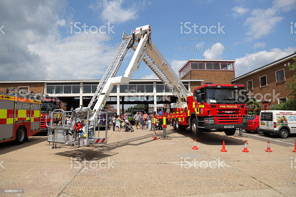 hydraulic rescue lift and fire engine against blue sky stock photo