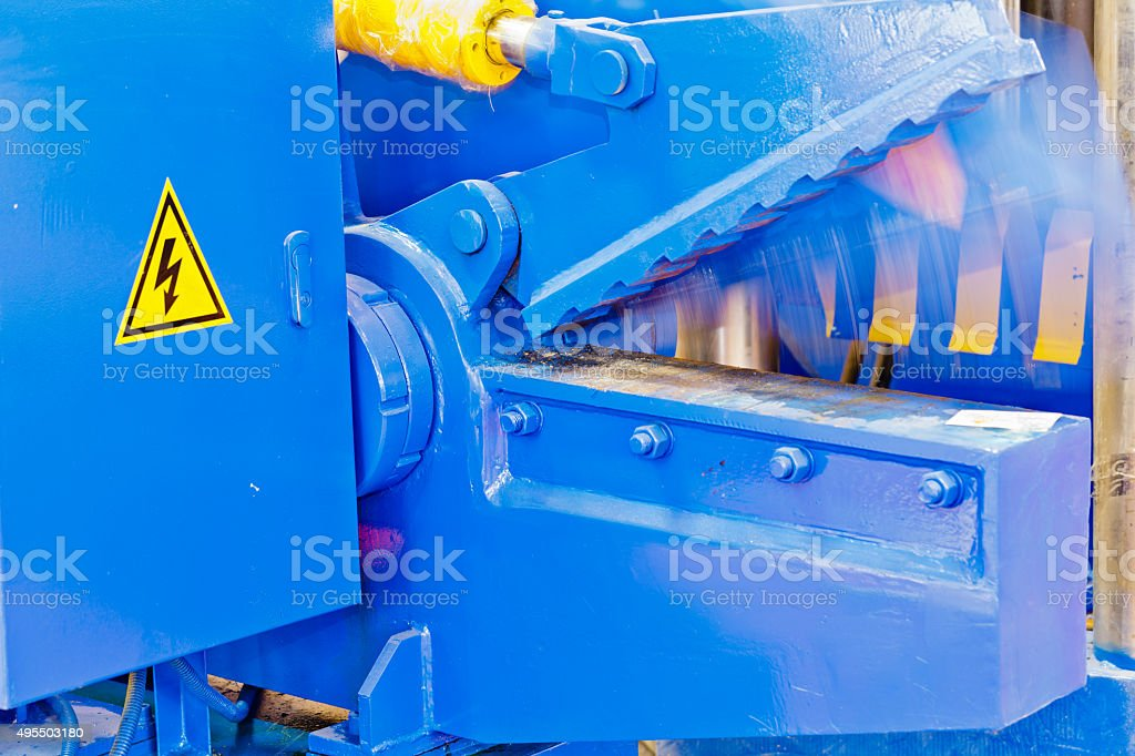 hydraulic steel scrap shearer in working stock photo