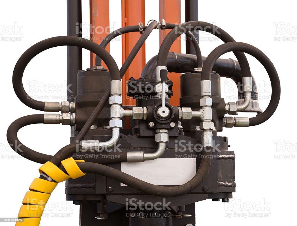 Hydraulic tubes, fittings and levers on control panel of lifting stock photo