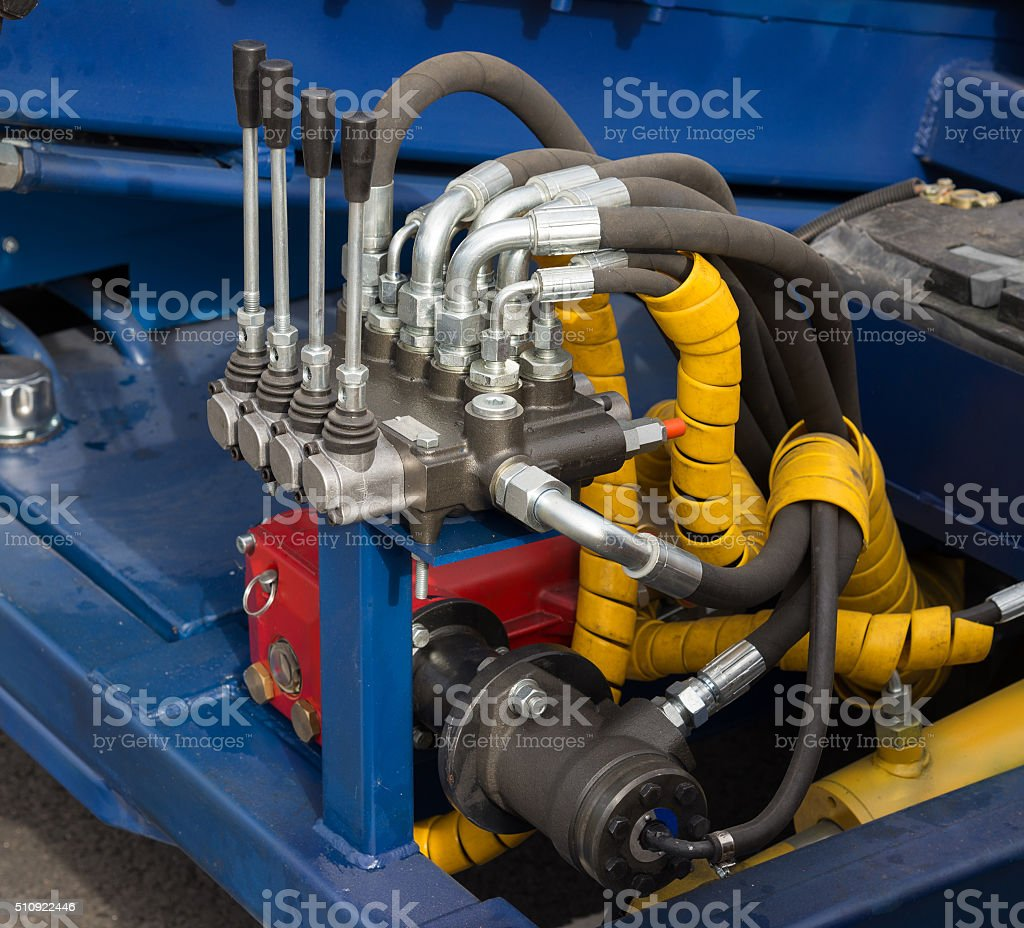 Hydraulic tubes, fittings and levers stock photo
