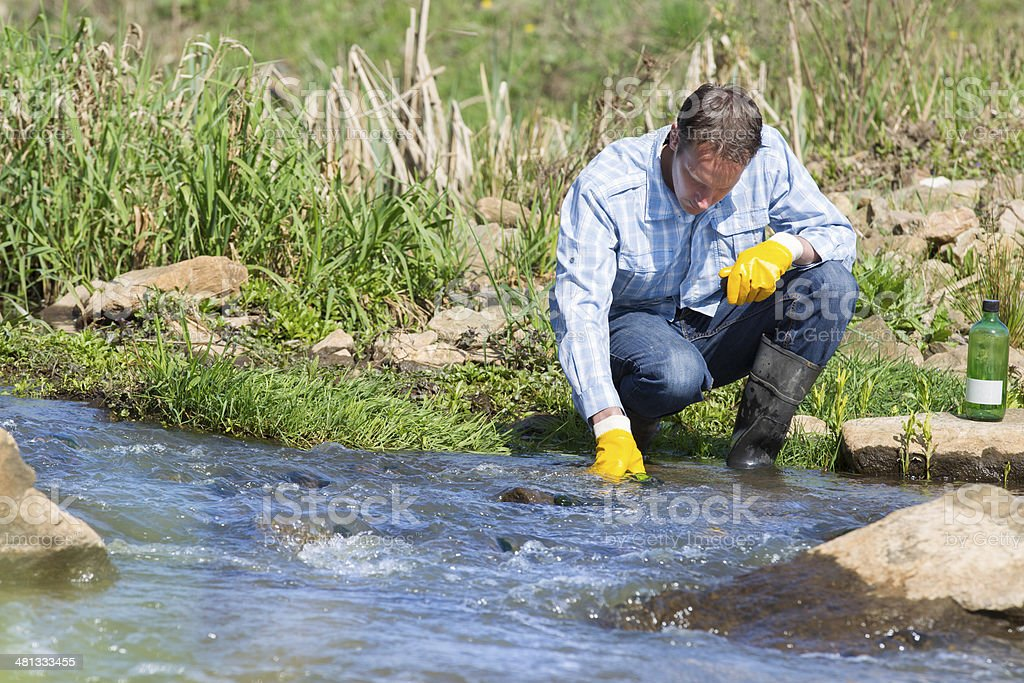 Hydro biologist testing quality of water stock photo