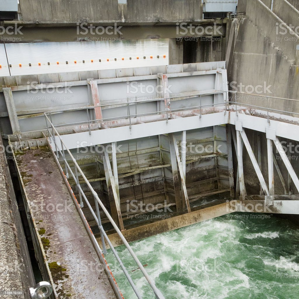Hydro dam control weir with underneath discharge royalty-free stock photo