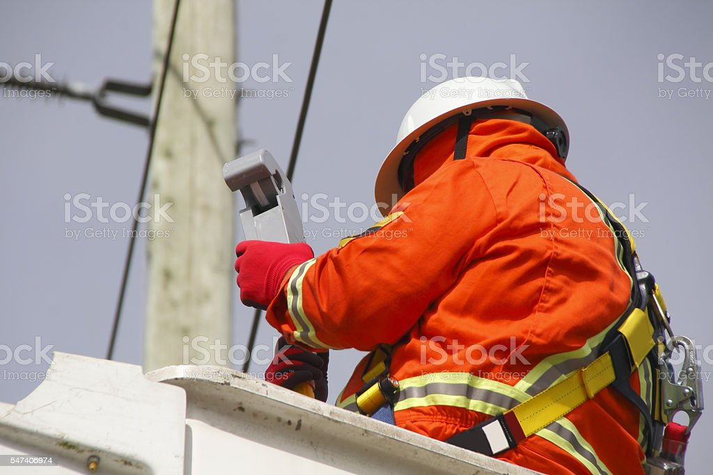 Hydro Electric Linesman Checks Voltage Reader stock photo