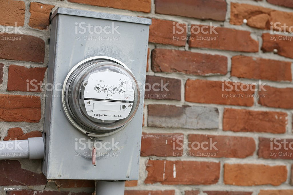 Hydro meter against brick wall. stock photo