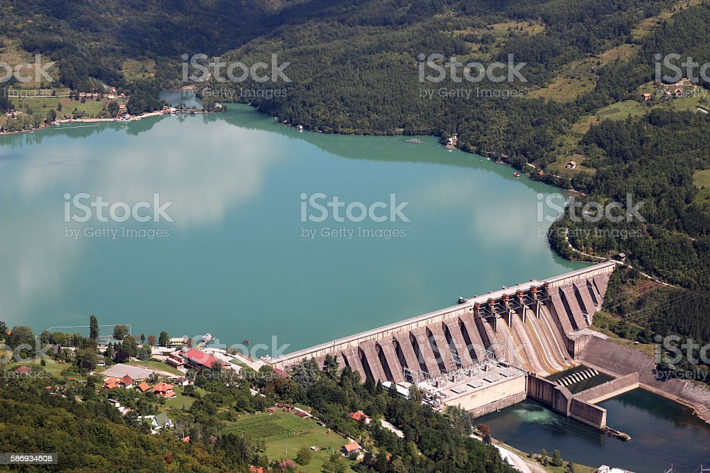 hydroelectric power plant on river landscape stock photo