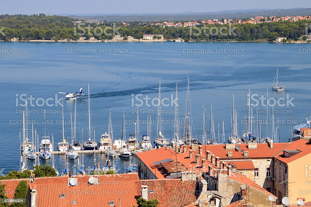 Hydroplane landing on the water in the bay of Pula stock photo