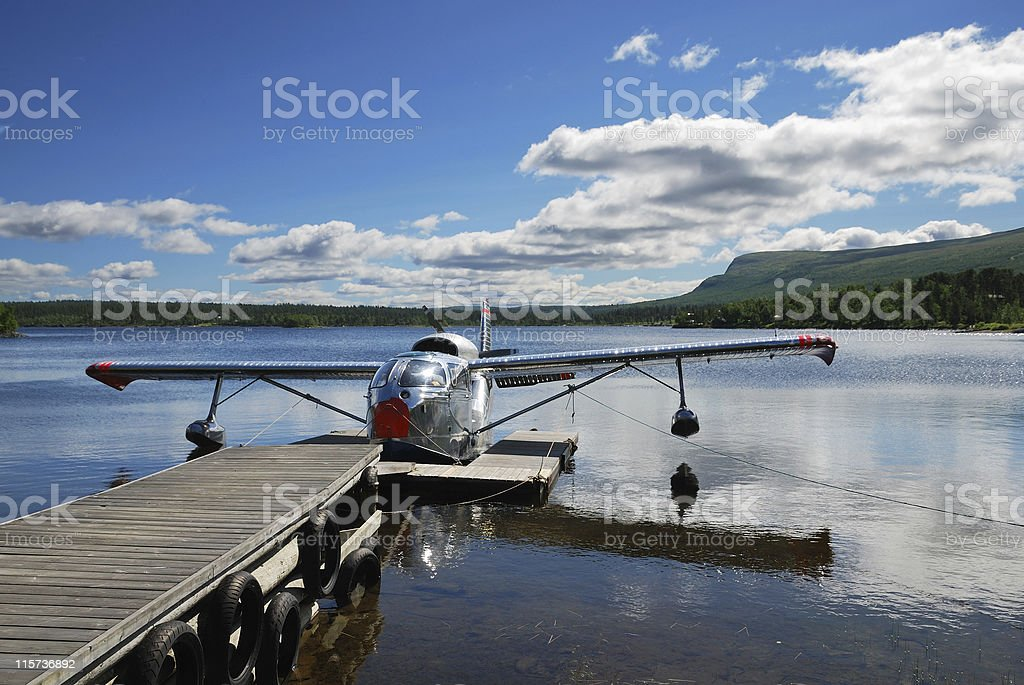 Hydroplane moored to pier on lake. royalty-free stock photo