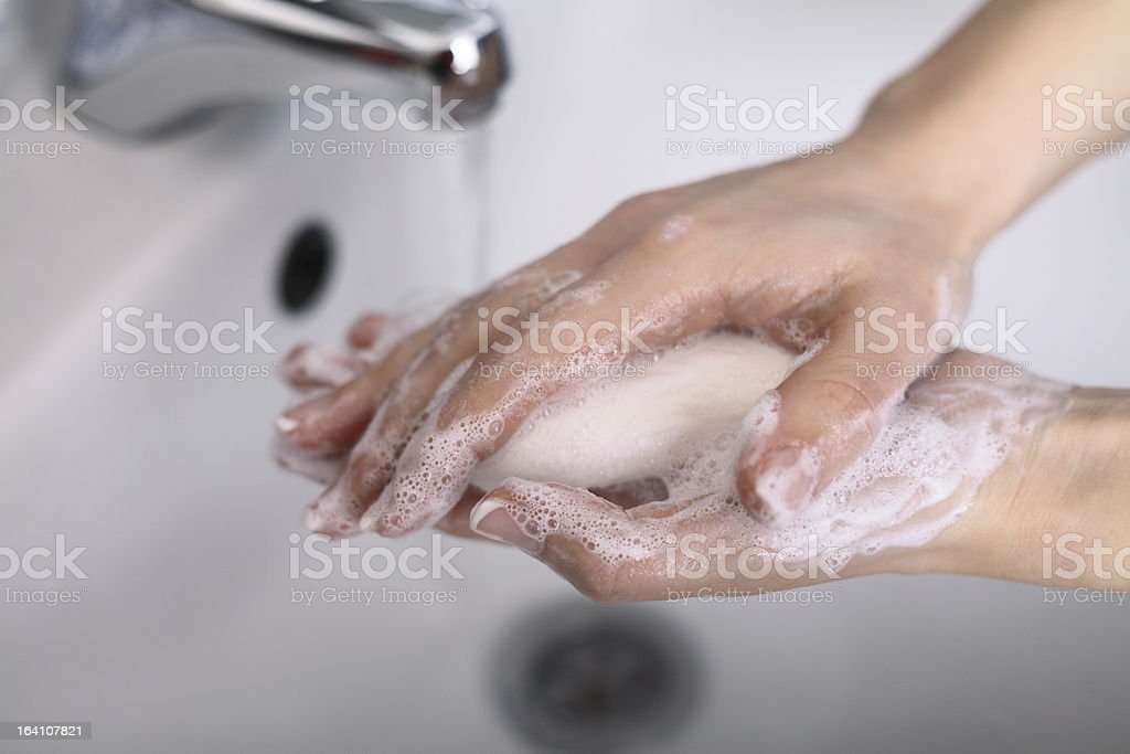 Hygiene concept of someone washing their hands with soap stock photo