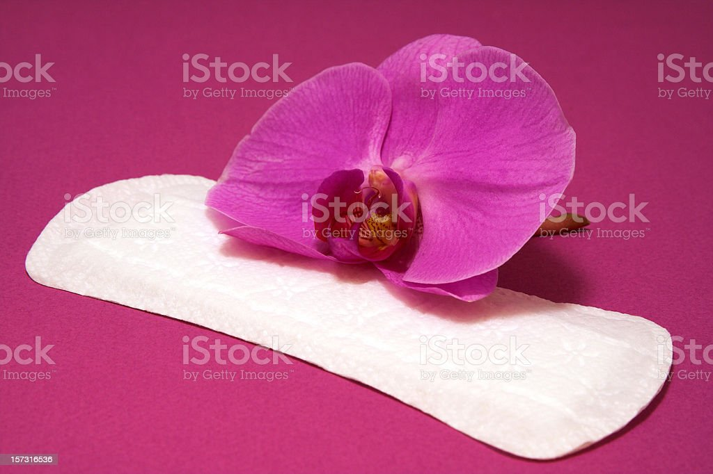 Hygiene pad with pink orchid stock photo