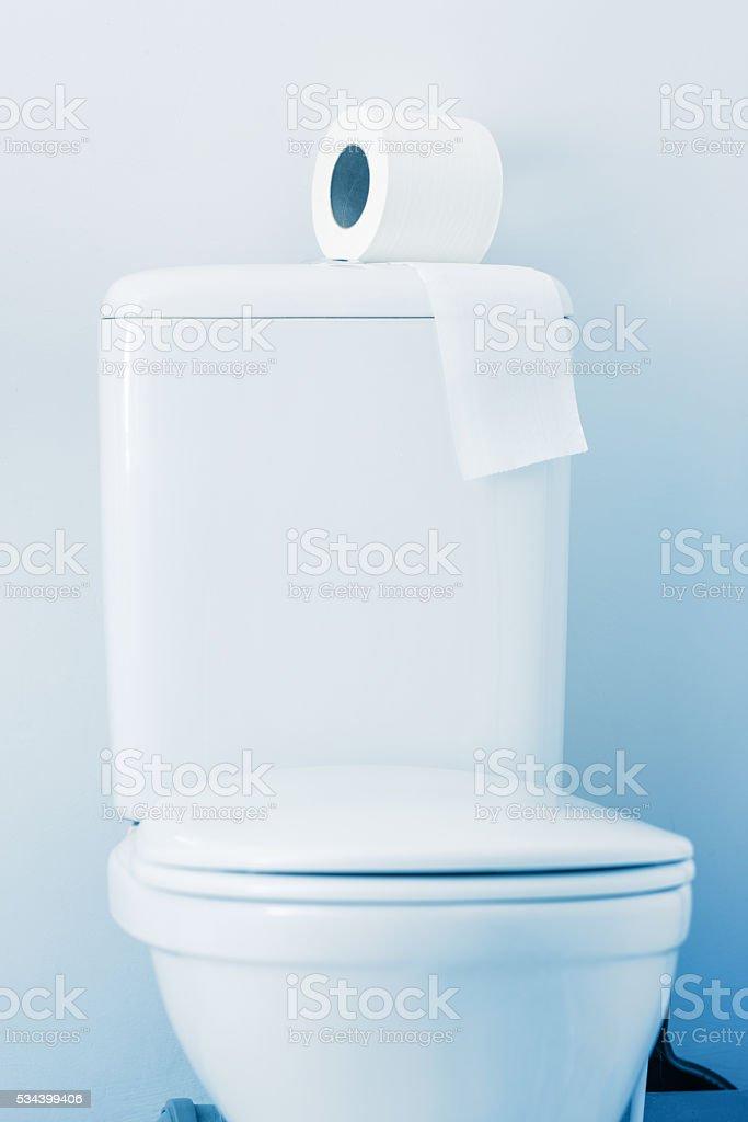 Hygienic paper on white toilet tank stock photo