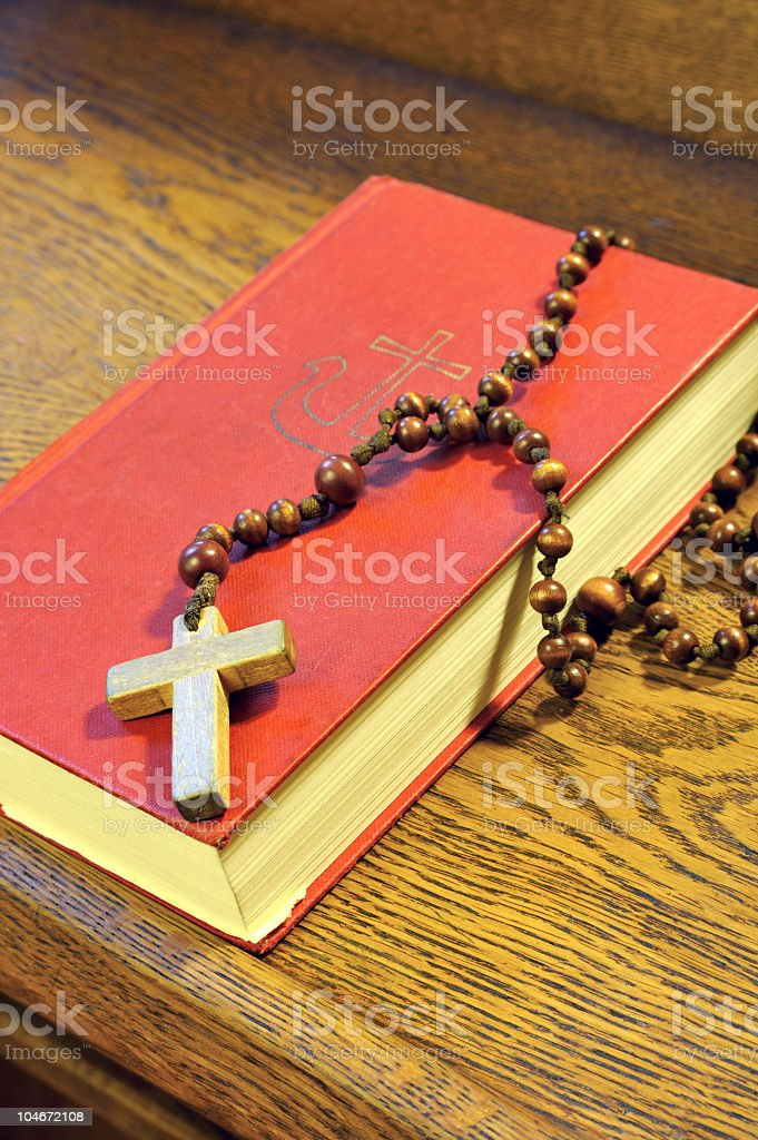 Hymnal  book and wooden rosary bead- detail royalty-free stock photo
