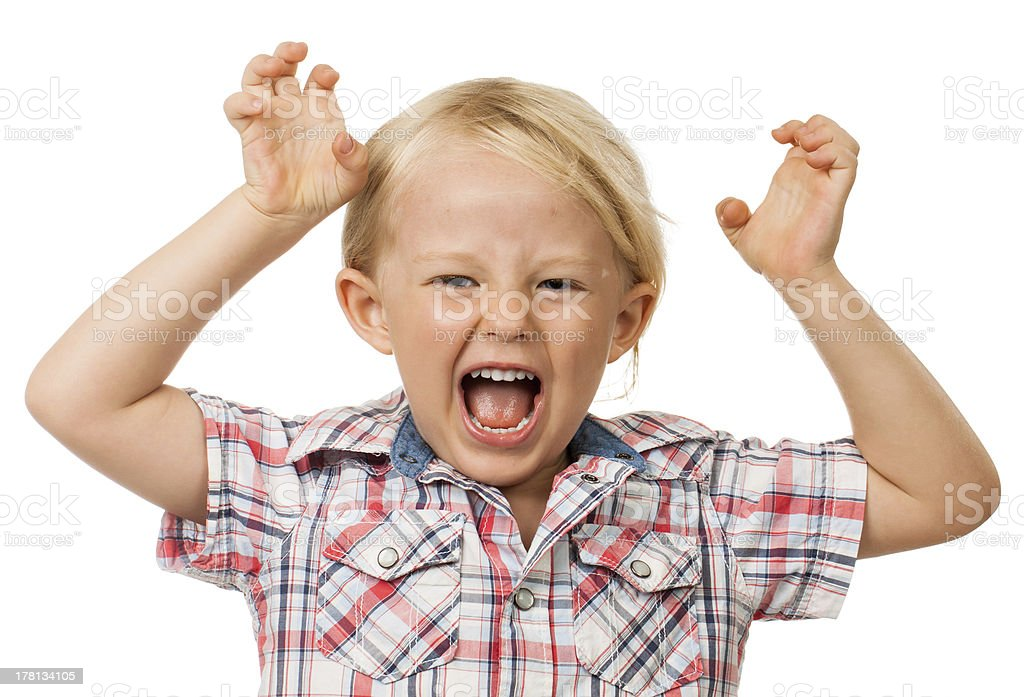 Hyperactive young boy stock photo