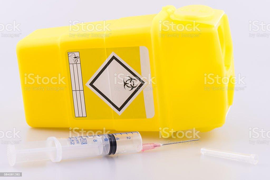 Hyperdermic needle and sharps bucket stock photo