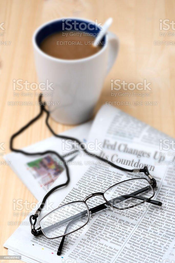 Hypermetropia Glasses and Newspaper with Coffee Mug stock photo
