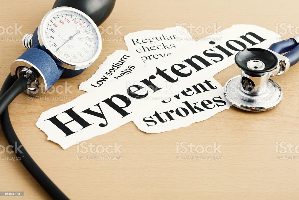 Hypertension headline with blood pressure gage and stethoscope royalty-free stock photo