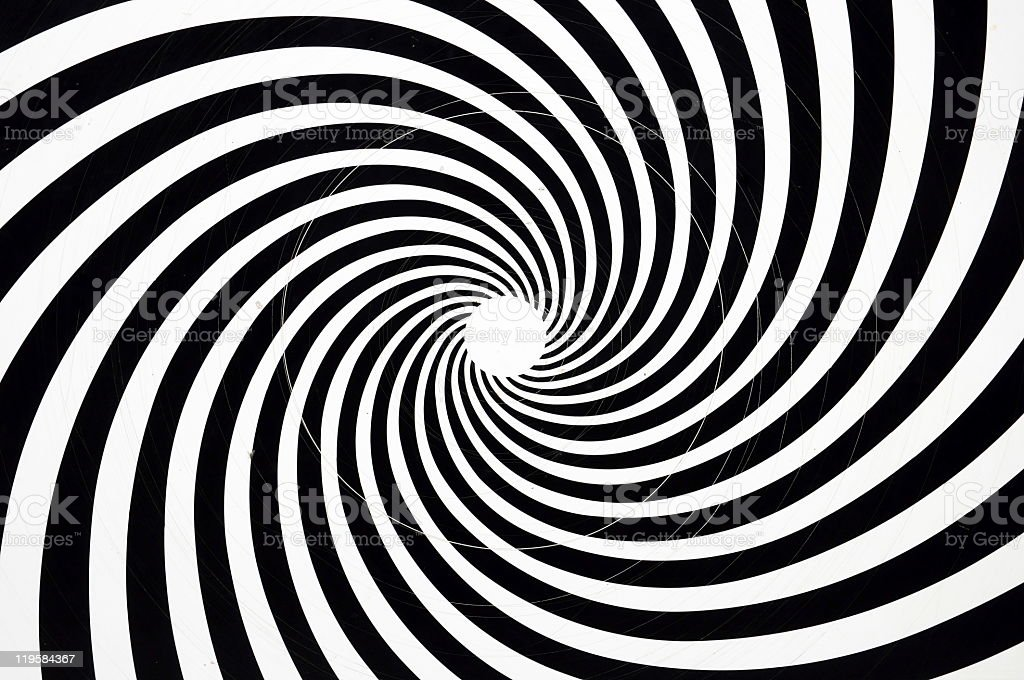 A hypnotic black and white spiral stock photo