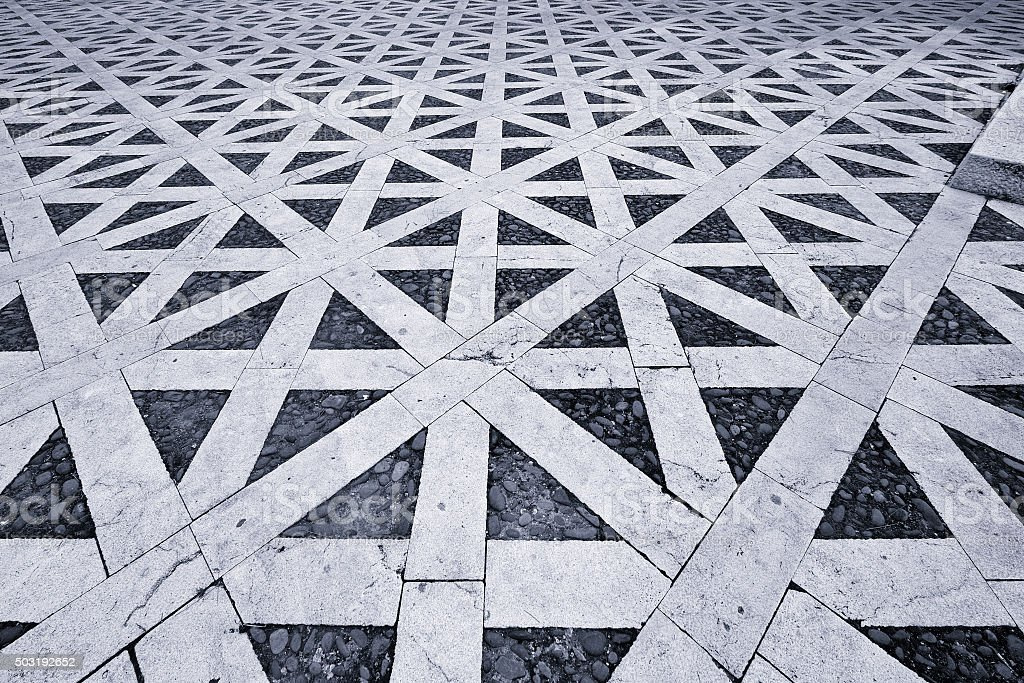 Hypnotic pattern in ancient Italian pavement stock photo