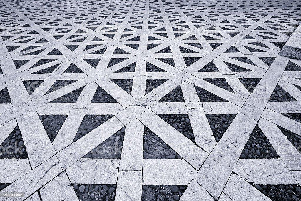 Hypnotic pattern in ancient Italian pavement stock photo