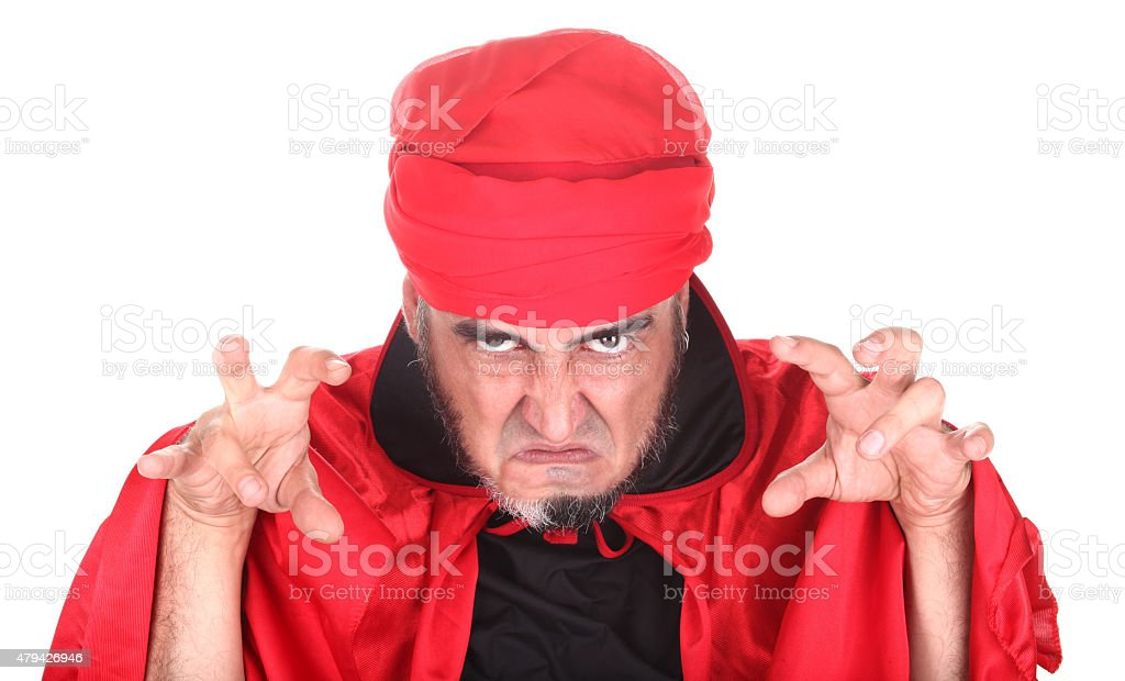 Hypnotist or sorcerer is doing hypnosis or magic stock photo