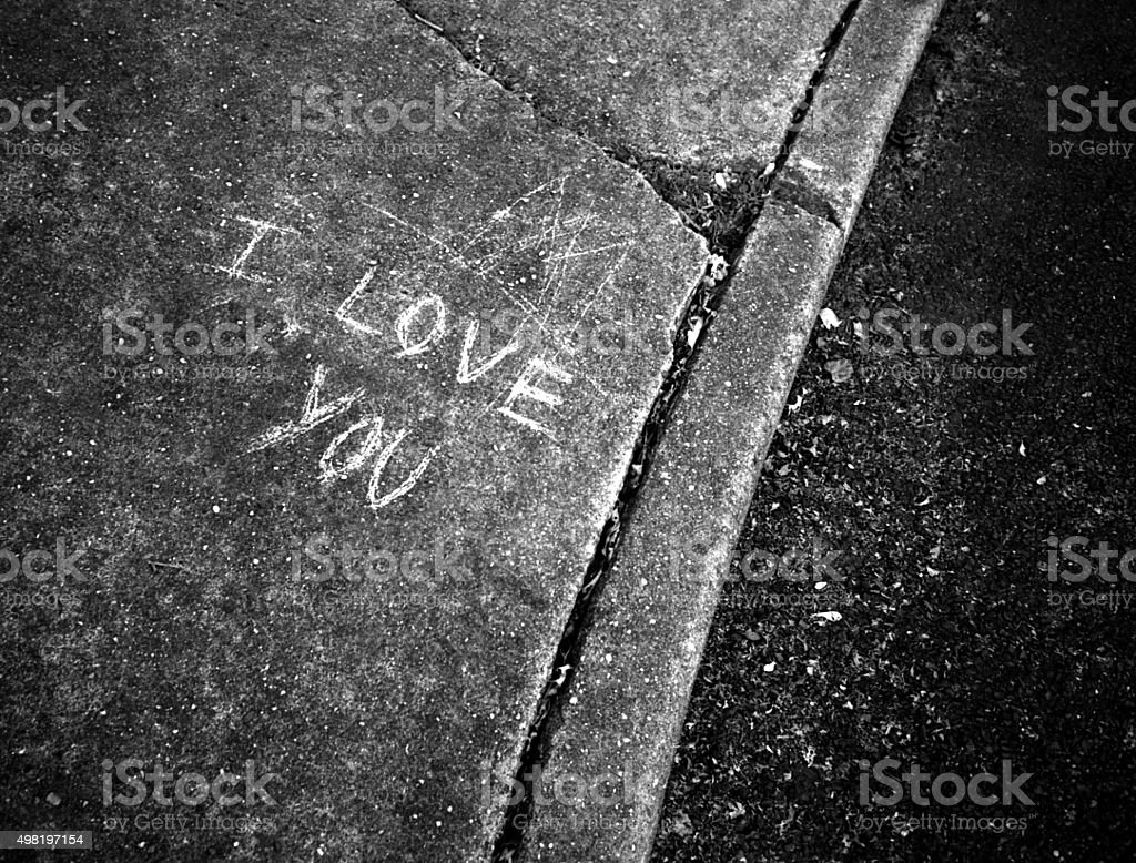 i Love You Scrawled on the Sidewalk stock photo