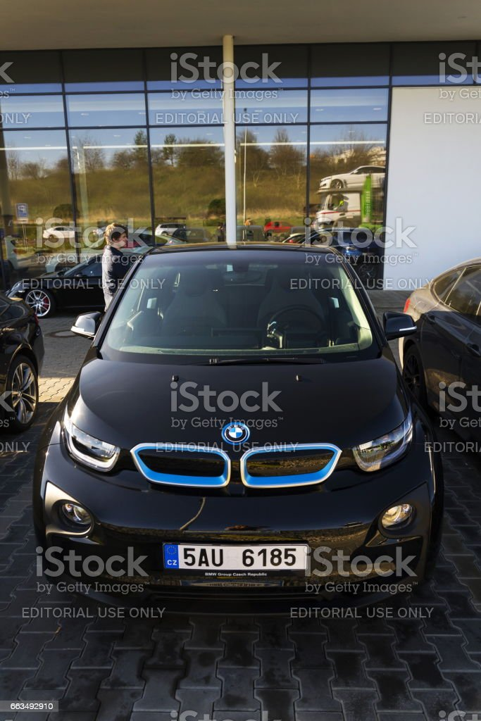 BMW i3 car company logo in front of dealership building stock photo