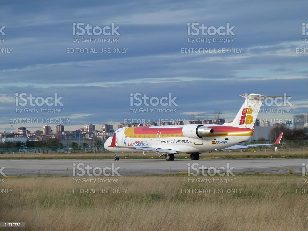 Iberia regional airplane departing stock photo