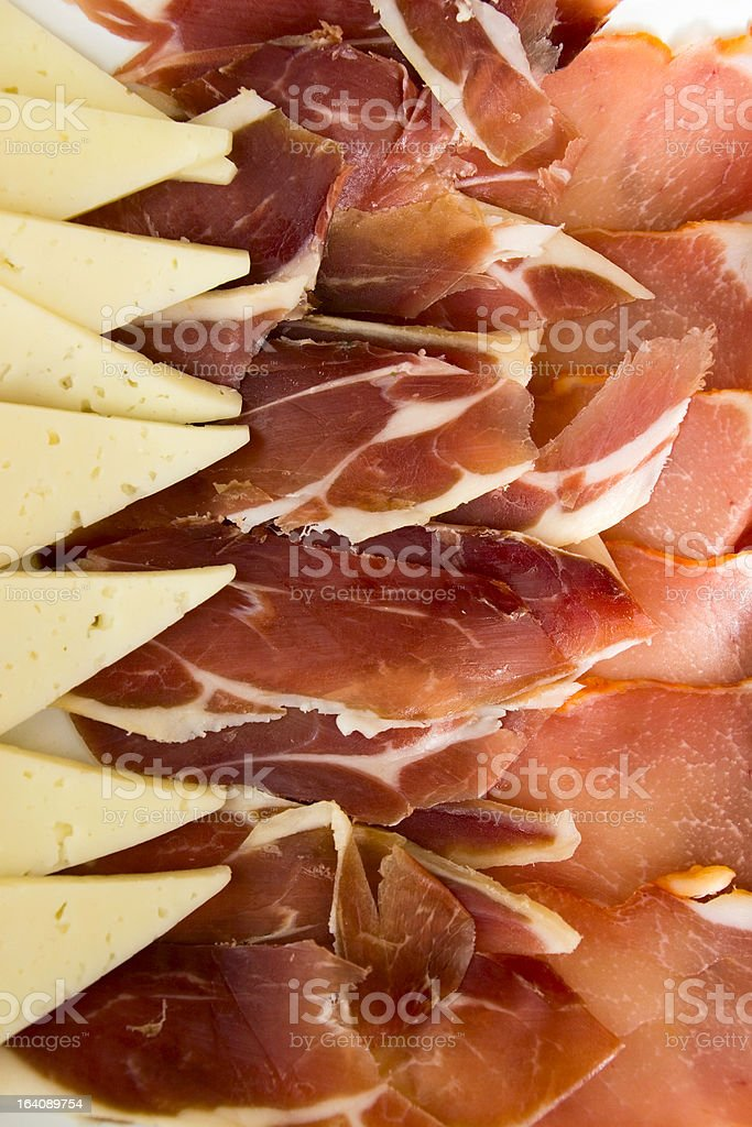 Iberian plate and manchego cheese stock photo