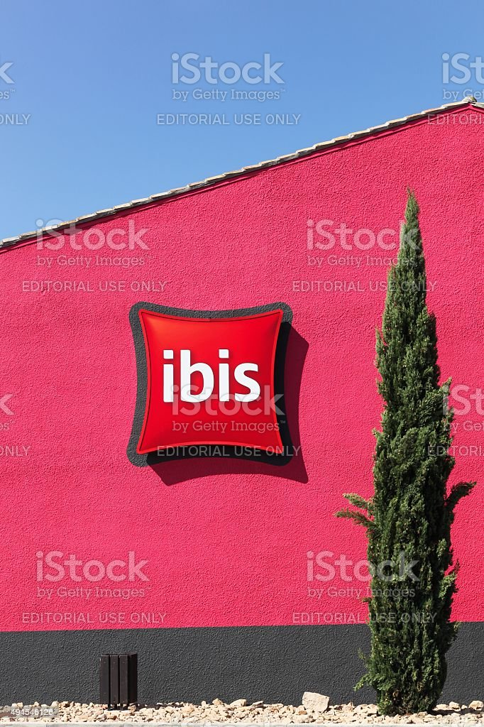 Ibis hotel sign on a red wall stock photo