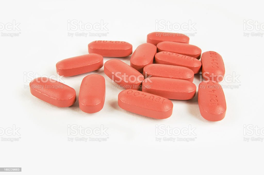 Ibuprofin Red Pills on White stock photo