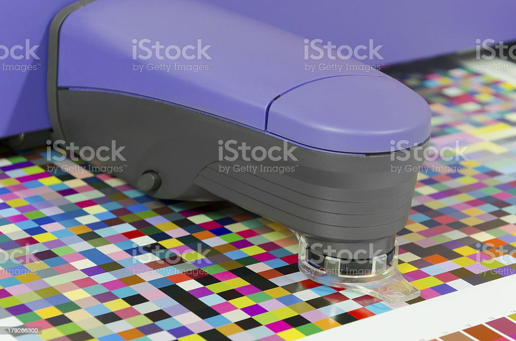 icc profiling, spectrophotometer robot measures color patches on Test Arch stock photo