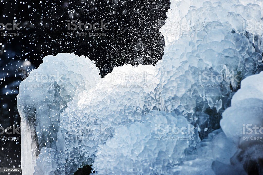 Ice and water spray stock photo