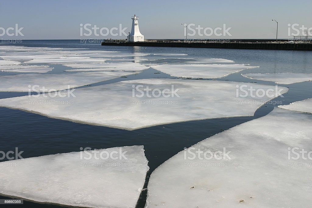 Ice at the lighthouse royalty-free stock photo