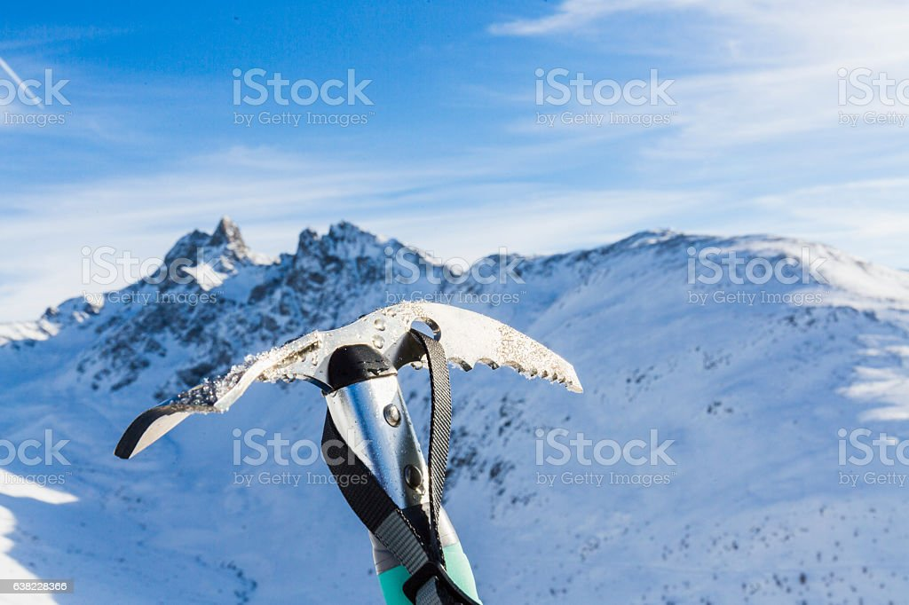 Ice ax and mountains range stock photo
