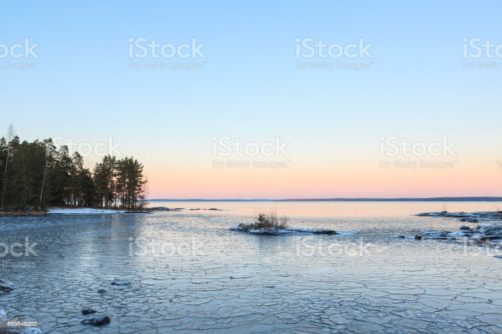 Ice blocks on freezing lake at dusk stock photo