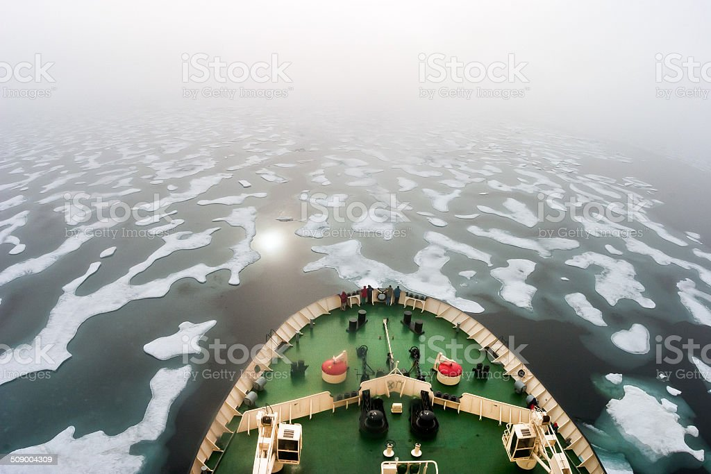 Ice breaker heading in the fogy NE Passage Russia stock photo