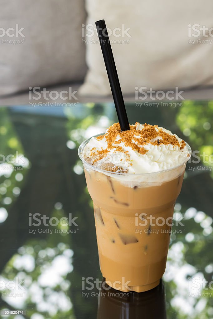 Ice caramel coffee with whipped cream stock photo