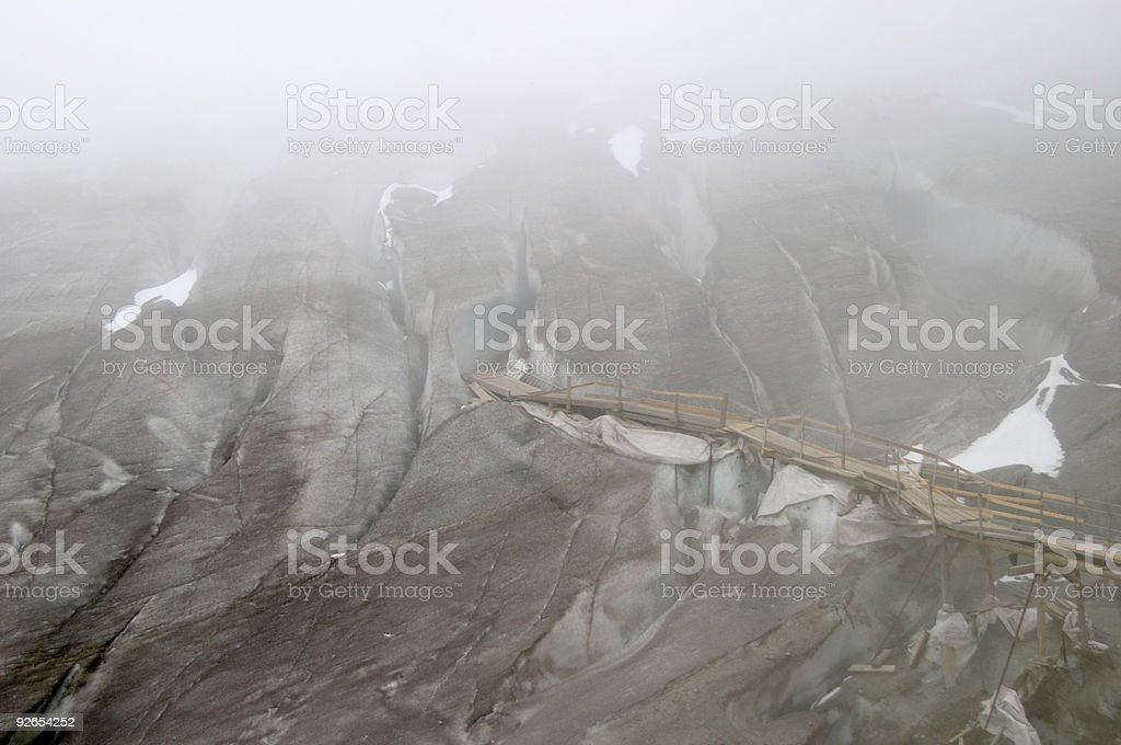 Ice cave entrance (Eisgrotte am Rhonegletscher), fog and crevass royalty-free stock photo