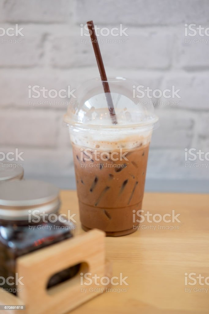 Ice chocolate with milk in a glass on wood table stock photo