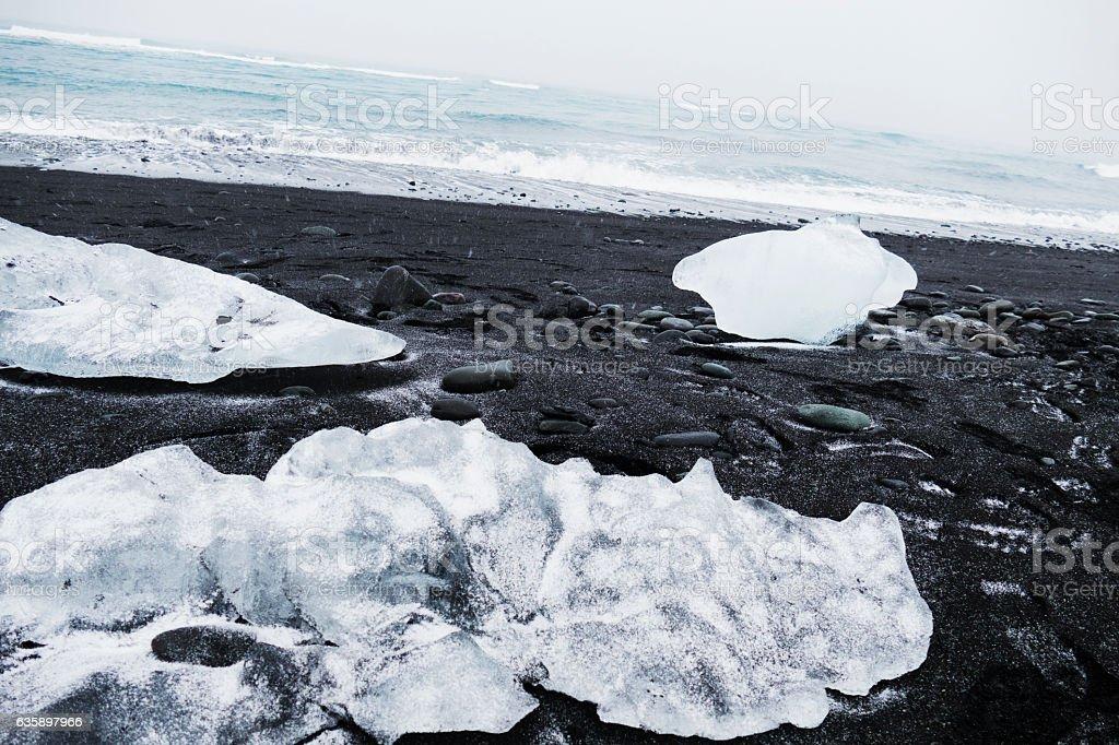 Ice chunks on the black sand Jokulsarlon lava beach,Iceland stock photo