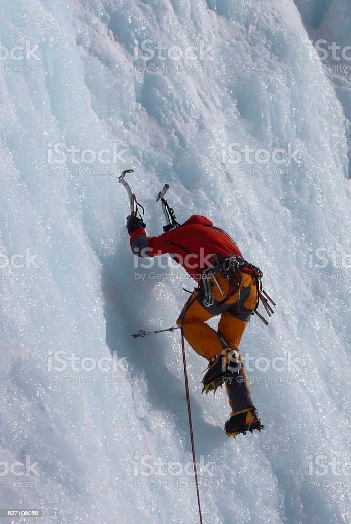 ice climber in the Swiss. Alps stock photo