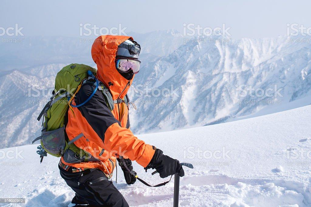 Ice Climber making his way through the snow stock photo