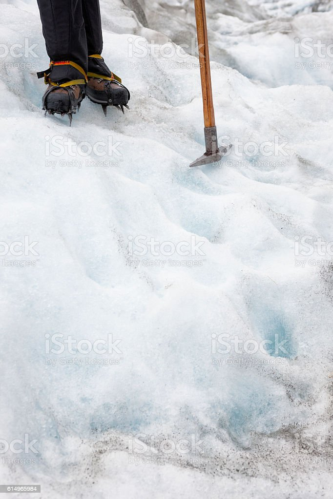 Ice climber on Franz Josef Glacier in New Zealand stock photo