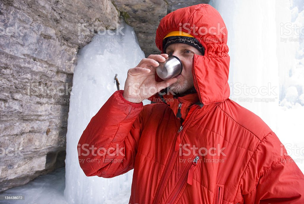Ice Climber Sips Hot Tea Beverage stock photo