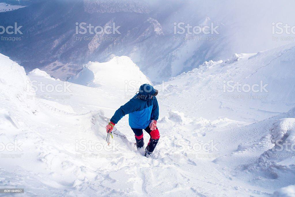 Ice climber taking a short break on a mountain stock photo