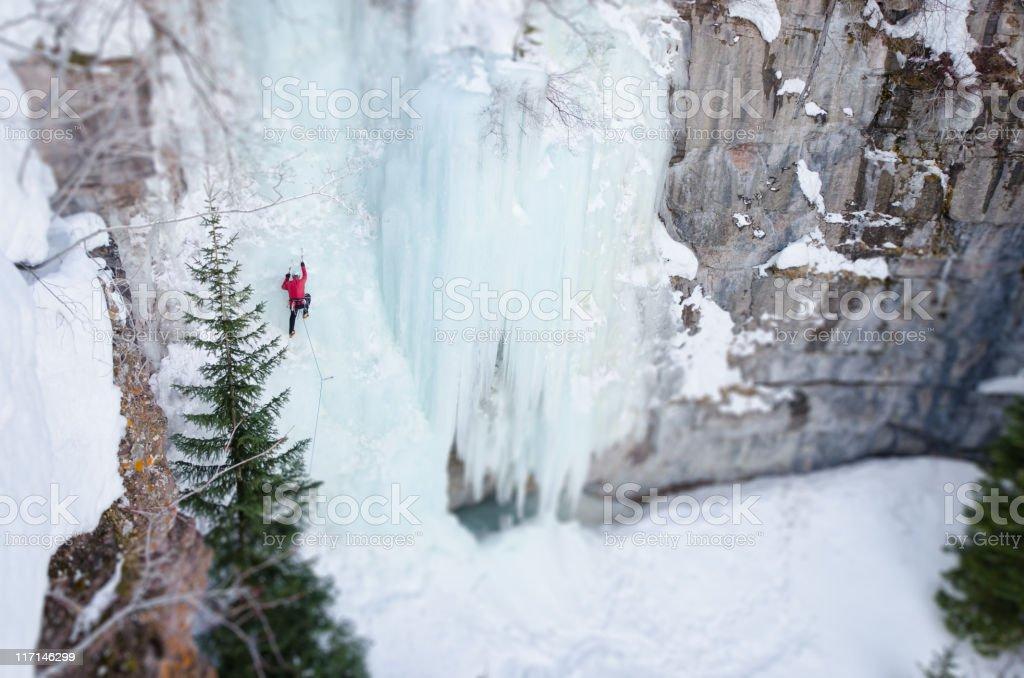 Ice Climbing Steep Frozen Waterfall in Winter stock photo