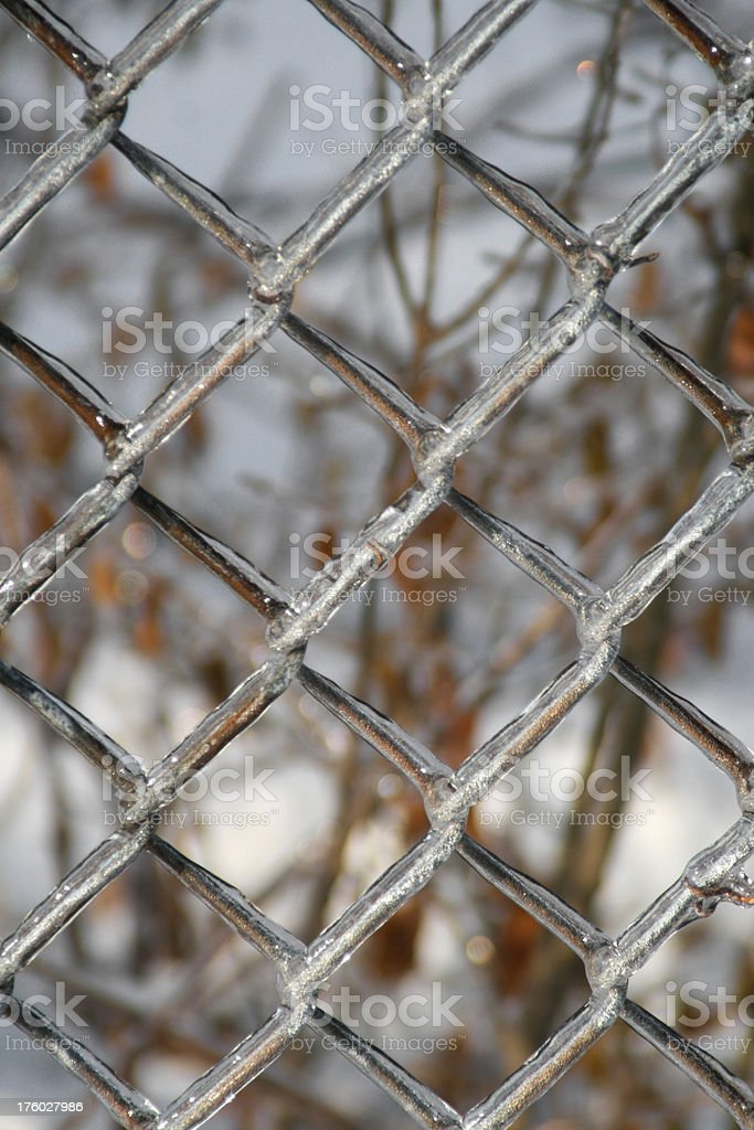Ice coats chain link fence. royalty-free stock photo