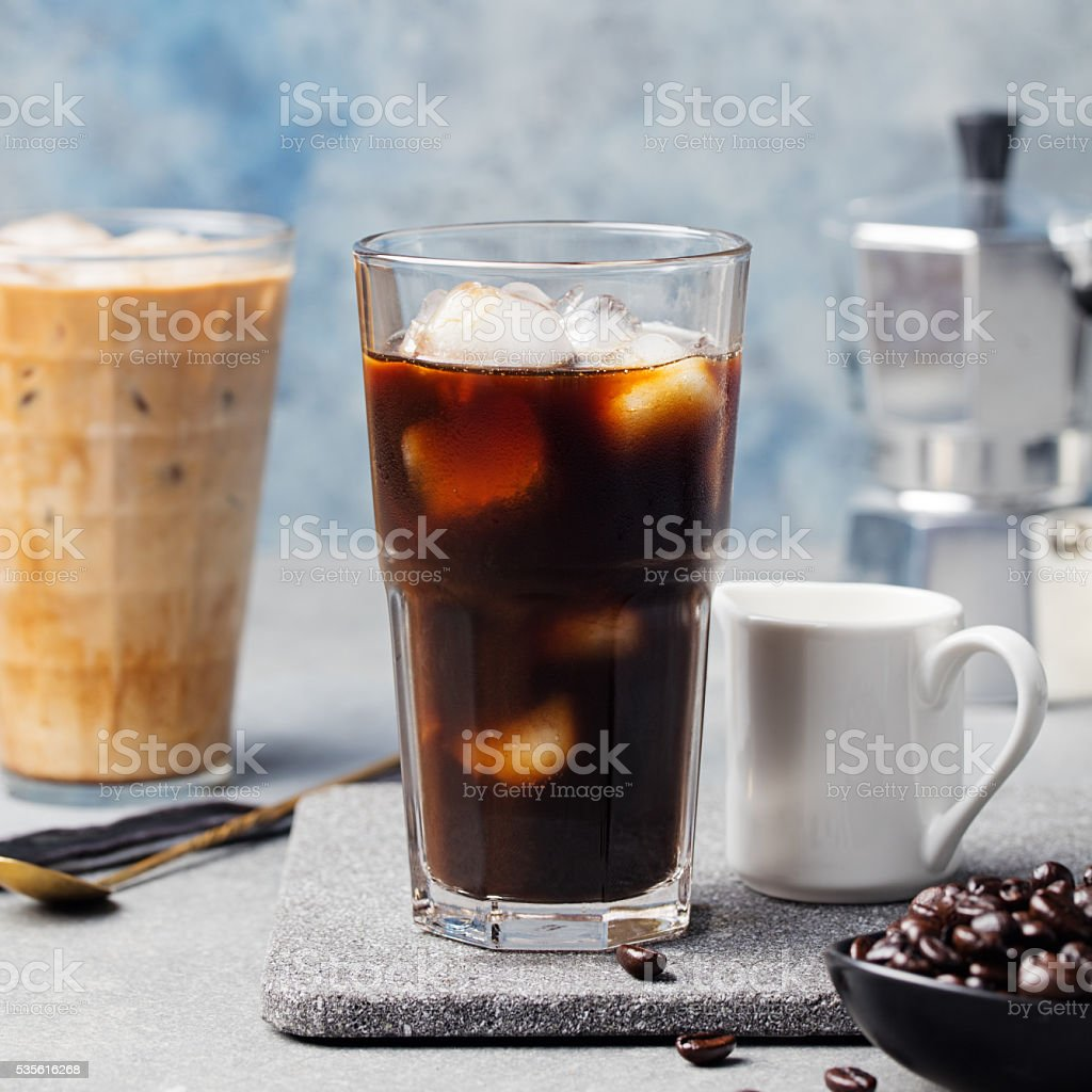 Ice coffee in a tall glass and coffee beans stock photo