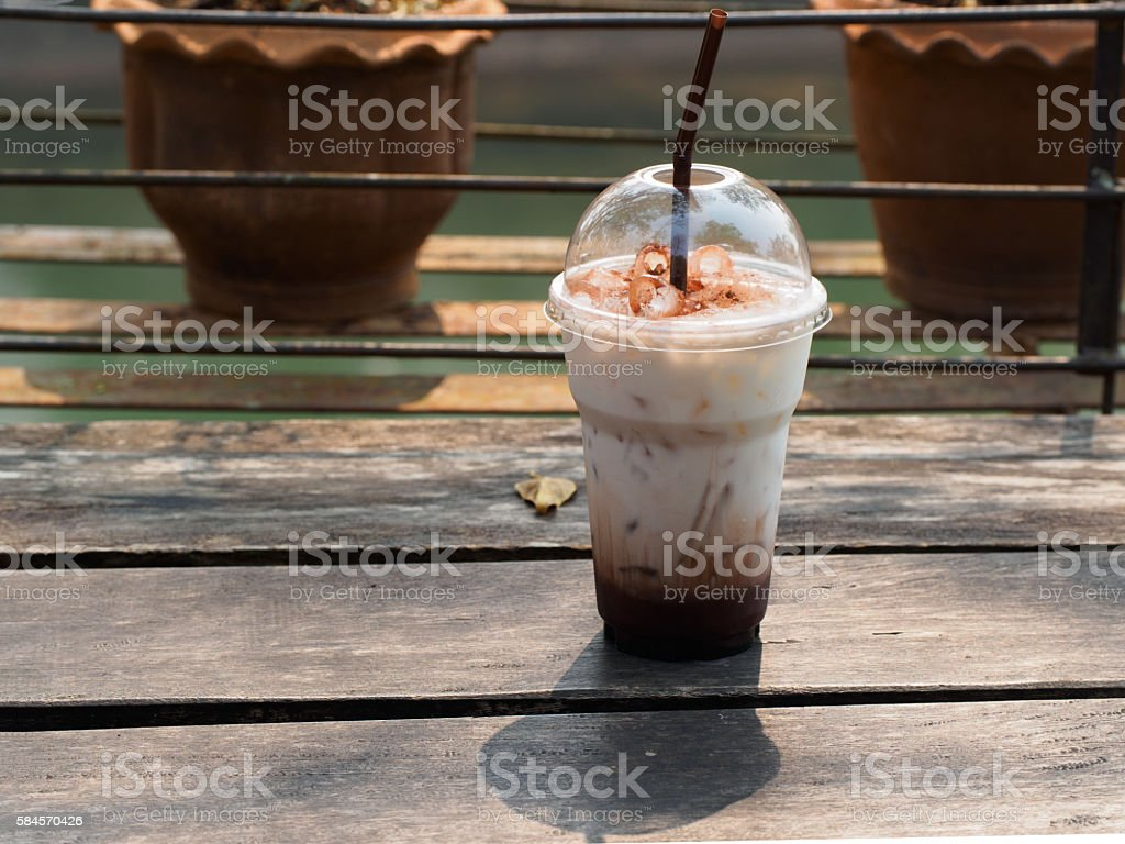 Ice coffee on a wooden table. Cold drink. stock photo